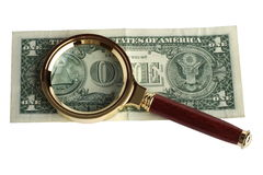 Dollar under a magnifier Stock Photos