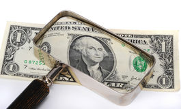 Dollar under magnifying glass Stock Images