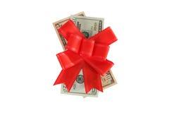 Dollar unter einem roten Bogen auf Weiß Stockbilder