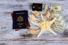 Dollar with passport and Money saving and travel holiday concept. Dollar with US Passport and international currenciest and Money saving and travel holiday royalty free stock photography