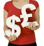 Dollar versus pound Stock Photography