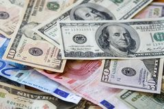 Dollar vs Euro. Background from dollars and euro. US Paper Currency Royalty Free Stock Photos