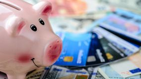 Dollar vs euro banknotes, piggy bank and credit cards as backgro. Und. Concept of savings, payment and credit stock image