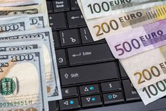 Dollar vs euro notes as background. For business concept Stock Image