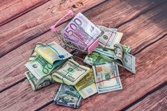 Dollar vs euro notes as background. For business concept Royalty Free Stock Image