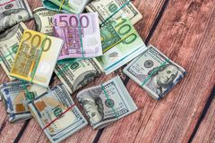 Dollar vs euro notes as background. For business concept stock photos
