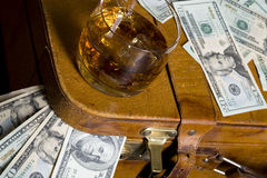 Dollar and whisky Stock Photos