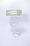 Dollar and wine glass Royalty Free Stock Images