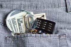 Dollar With Phone In Pocket Stock Images