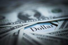 Dollar written newspaper, shallow dof, real newspaper and dollar. Bills stock image