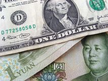 Dollar And Yuan. One us dollar and one chinese yuan Stock Image