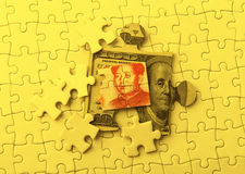 Dollar and Yuan on Puzzle Stock Images