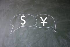 Dollar and yuan symbol. Blackboard royalty free stock photography