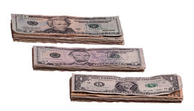 Dollaranmärkningar i tre buntar Arkivfoto