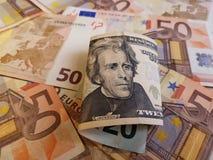 20 dollarbankbiljet en achtergrond met euro bankbiljetten Royalty-vrije Stock Foto