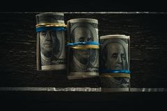 Dollarbankbiljetten in broodjes Stock Foto's