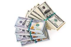 Dollarbankbiljetten in stapels stock foto's
