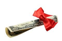 Dollarbanknote als Weihnachtsgeschenk lizenzfreie stockbilder