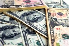 Dollarbanknote-Geldhintergrund stockfoto