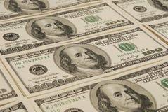 Dollarbanknoten-Geldhintergrund Stockfotografie
