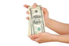 Dollarbanknotengeld in der Hand Lizenzfreie Stockfotos