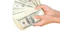 Dollarbanknotengeld in der Hand Stockfotos