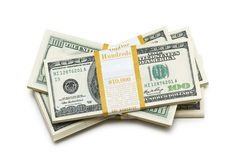 dollaren staplar tio tusen Arkivfoto