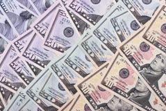 Dollari americani astratti del fondo dei soldi delle denominazioni differenti Fotografia Stock