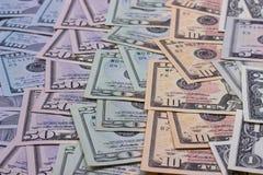 Dollari americani astratti del fondo dei soldi delle denominazioni differenti Immagini Stock