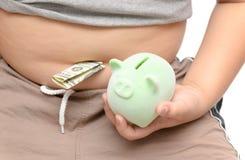 Dollari americani con il grandi ragazzo e porcellino salvadanaio della pancia a disposizione Fotografia Stock