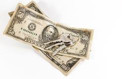 Dollari americani e chiavi americani della Camera Fotografia Stock Libera da Diritti