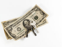 Dollari americani e chiavi americani della Camera Fotografia Stock