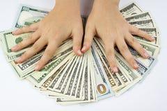 Dollari americani e mani Fotografia Stock Libera da Diritti