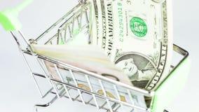 Dollari in carretto video d archivio