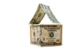 Dollari che formano una casa su priorità bassa bianca Fotografie Stock