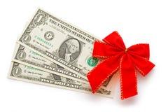 Dollari con l'arco di feste fotografia stock libera da diritti
