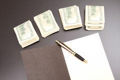 Dollari con un quaderno Fotografie Stock