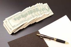 Dollari con un quaderno Immagini Stock Libere da Diritti