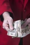 Dollari dei soldi disponibili Fotografia Stock