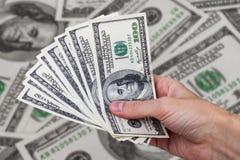 Dollari dell'americano dei contanti Fotografia Stock