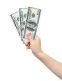 Dollari della holding della mano Fotografia Stock Libera da Diritti