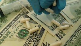 dollari delle capsule di guanti della mano, fucilazione lenta archivi video