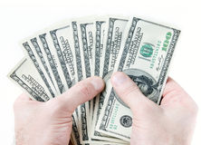 Dollari di banconote in mani maschii Immagini Stock Libere da Diritti