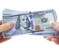 Dollari di fatture in mano due Fotografie Stock