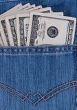 Dollari di fatture in tasca dei jeans Fotografia Stock