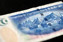 20 dollari di Hong Kong su un fondo scuro Fotografia Stock Libera da Diritti