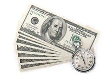 Dollari di soldi e cronometro Fotografia Stock
