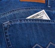 Dollari di soldi in tasca dei jeans Fotografie Stock
