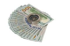 Dollari e bussola su un fondo bianco Fotografia Stock Libera da Diritti