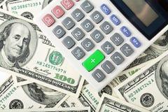 Dollari e calcolatore Fotografie Stock